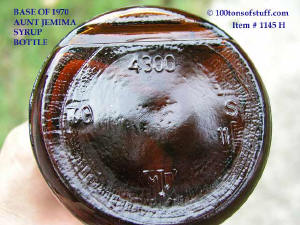 Base of #1145 H Medium size 1970 Aunt Jemima old glass bottle shows orientation indent and base marks