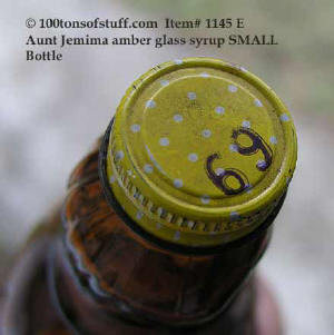 item 1145 polka dot metal cap marked 69 cents for 1960 Aunt Jemima glass bottle