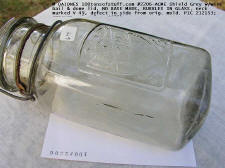 side mold mark of #2206 ACME SHIELD QT, grey w/wire bail & glass lid