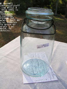 #2217 A - QT clear lite blue green glass w/bubbles, wire bail no lid; only embossed on base: TRADEMARK LIGHTNING PUTNAM 564