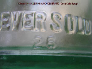 Embossed words and nbr 25 on 1414-CJERING-Anchor Brand Root Cola Syrup