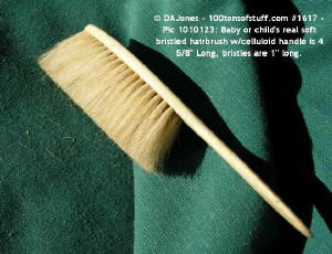 100tos1617: Baby celluloid real bristle hairbrush.