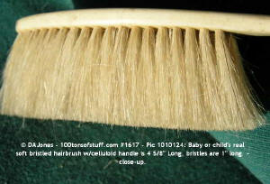 Side view of bristles of 100tos1617: Baby celluloid real bristle hairbrush.