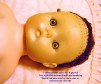 #1612 close-up of face of old rubber doll w/realistic eyes