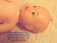 #1613 close-up of baby face of old rubber doll
