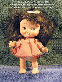 #1614 small big headed troll type doll w/lots of brown hair