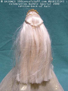 Celebration Barbie 2000 with stand - back showing long blond hair.