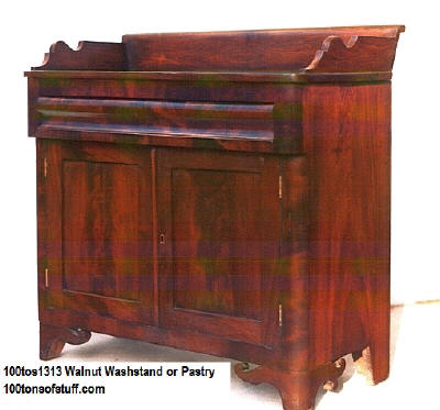 100tos#1313 Walnut Pastry or Wash Stand w/drawer & 2 door storage cupboard & skirted bottom.