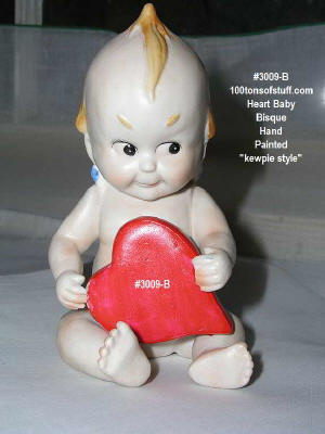 100tos#3009B Kewpie angel w/big red heart - cast pottery - for Valentines Day! Item 3009B