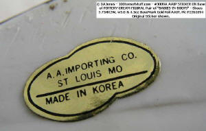 "From Item 3009 A - base metalized tag ""A.A.Importing Co., St. Louis, MO, Made in Korea"""