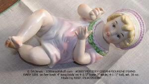 Item 3007 Piano Baby Girl on back hand painted bisque 1970s view 1