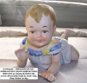 Item 3008 Piano Baby Boy face view crawling, hand painted bisque 1970s
