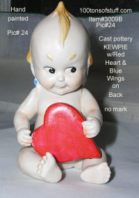 3009B - Kewpie doll sitting w/red heart & blue wings made of cast pottery hand painted 1970's or earlier no mark.