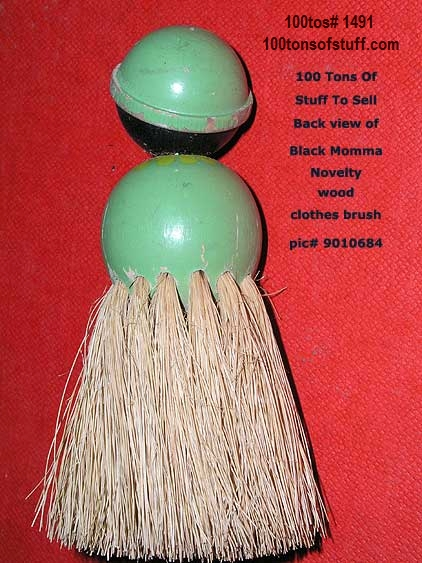 100tos1491: Back of black hula style girl clothes brush w/real bristles - souvenir.