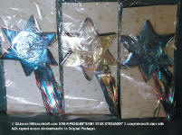 0798-R-PB246498-XMAS-3 Shiny Star Expanding Banners in original plastic - never used - expand to show various colors.
