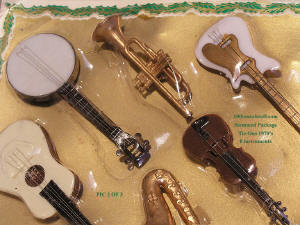 Close-up Item# 1542 - Circa 1970 Stemmed Package Tie-Ons of 8 Musical Instruments on Orig. Store Card