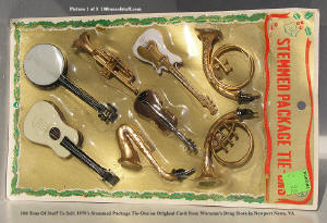 Item# 1542 - Circa 1970 Stemmed Package Tie-Ons of 8 Musical Instruments on Orig. Store Card