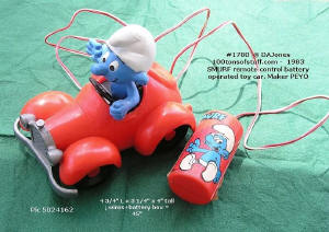 100tos1780: Smurf remote control battery operated toy car - rare.